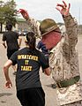 Defense.gov News Photo 110506-M-8136F-143 - Drill instructor Sgt. Bryce E. Torrence explains the importance of moving quickly while members of the Delayed Entry Program from Recruiting.jpg