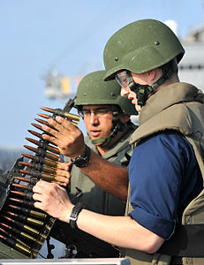 Defense.gov News Photo 120328-N-DB801-466 - U.S. Navy Petty Officer 1st Class Eduardo Soto left instructs Seaman Tyler Bishop on firing a .50 caliber machine gun during a live-fire exercise.jpg