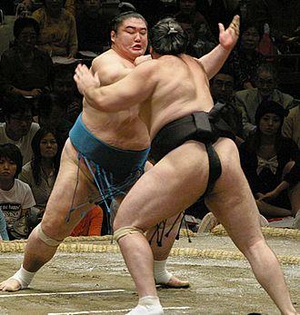 Dejima Takeharu - Dejima demonstrating his thrusting techniques against Kokkai
