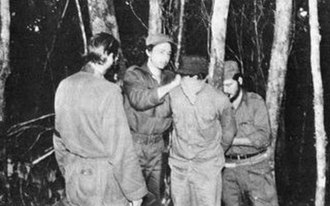Raúl Castro - Raúl Castro (second from left) is shown blindfolding a man to be shot by firing squad. Oriente Province, Cuba, circa 1958