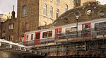 District Line arriving Whitechapel (15442523471).jpg