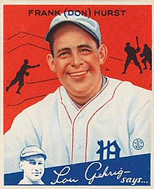 "A baseball card image of a smiling man wearing a white baseball uniform and cap with red trim and a blue Old English ""D"" over the left breast"