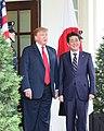 Donald Trump greeting Shinzo Abe at the gate 02.jpg