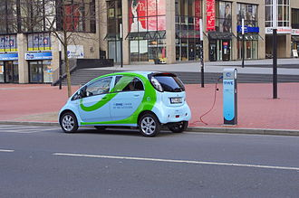 Electric vehicle network - A Mitsubishi i MiEV charging from a RWE charging station in Dortmund.