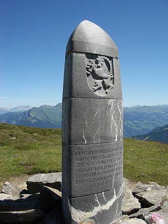 Tomils - Dreibündenstein, 1915 erected stone to mark the border of the Three Leagues