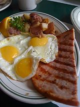 Grilled ham and fried eggs