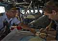 Elmer Magallanes, left, a harbor pilot in Manila, Philippines, helps U.S. Sailors aboard the amphibious dock landing ship USS Tortuga (LSD 46) plot a course as the ship crosses Manila harbor en route to Manila 130402-N-IY633-034.jpg
