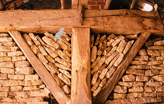"""Scarf joint - The scarf joint used on the beams above the post is known by its French name, trait de jupiter or """"bolt-o-lightning joint""""."""