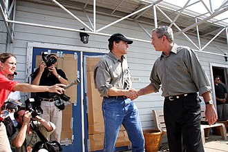 Rick Perry - President George W. Bush and Texas Governor Rick Perry shake hands September 27, 2005, after a question-and-answer session at the Port Arthur airport. Port Arthur suffered extensive damage from Hurricane Rita.