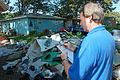 FEMA - 44902 - SBA Specialist writing on a clipboard in Iowa.jpg