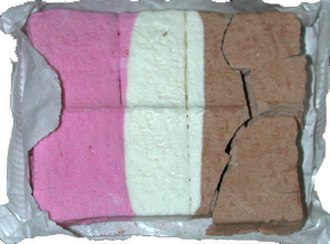 Freeze-dried ice cream - Freeze-dried Neapolitan ice cream, shown with air-tight foil partially unwrapped
