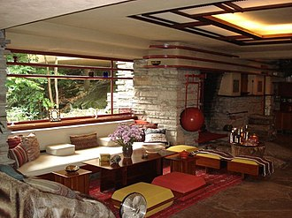 Fallingwater - The interior of Fallingwater depicting a sitting area with furnishings designed by Wright