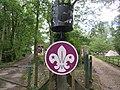 Ferny Crofts Entrance path, beacon and Scout fleur de lis.jpg