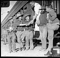 Fettlers meeting the train - a lantern slide used in lectures on all Australian Inland Mission activities, 1940- - (John Flynn?) (9448412634).jpg