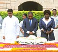 Filipe Jacinto Nyusi paying homage at the Samadhi of Mahatma Gandhi, at Rajghat, in Delhi on August 05, 2015. The Minister of State for Petroleum and Natural Gas (Independent Charge), Shri Dharmendra Pradhan is also seen.jpg