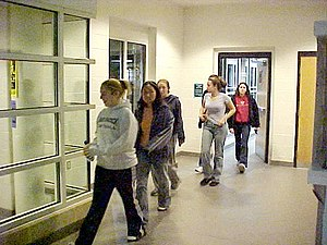 College students evacuate Potomac Hall, a dorm...
