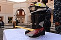 Firefighting gear is used as a memorial for the first responders during a 9-11 memorial ceremony Sept 140911-N-QY759-057.jpg