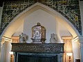 Fireplace with Decorative Tiles and Arch with marble Angels.jpg