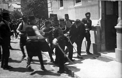 This picture is usually associated with the arrest of Gavrilo Princip, although some believe it depicts Ferdinand Behr, a bystander. Gavrilo Princip captured in Sarajevo 1914.jpg