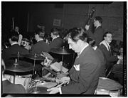 Gene Krupa playing two splash cymbals