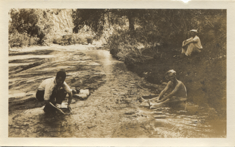 Three men cooling off in the Santa Cruz River (near Patagonia, Arizona, USA).