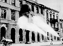 Black and white photograph] of German units using flame-throwers to burn down Warsaw's ruins