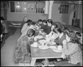 Granada Relocation Center, Amache, Colorado. A group of residents loll over their evening meal. - NARA - 539054.tif