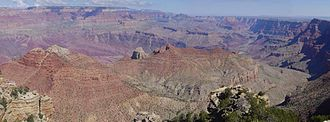 Geology of the Grand Canyon area - The Grand Canyon from Navajo Point. The Colorado River is to the right and the North Rim is visible at left in the distance. The view shows nearly every sedimentary layer described in this article.
