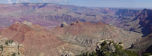 Wide canyon with exposed red- and tan-colored rock