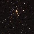Gravitational lensing in galaxy cluster.jpg