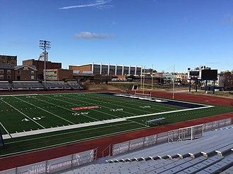 William H. Greene Stadium - Greene Stadium with Burr Gymnasium in the background.