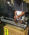 Grilling Hida Beef (Takayama Street Food) (35910429046).jpg