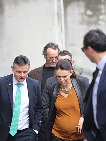 Ardern with Green Party co-leader James Shaw at Victoria University of Wellington, 12 April 2018 Group walking 2018.jpg