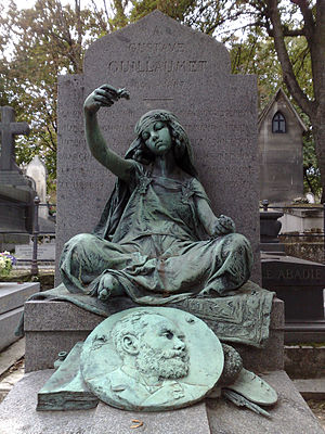 Louis-Ernest Barrias - Barrais' sculpture for tomb of Gustave Guillaumet, Montmartre Cemetery, Paris. Young girl from Bou Saâda dropping flowers onto a portrait of Guillaumet