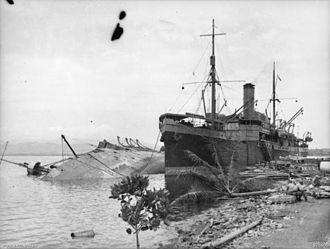 Battle of Milne Bay - Anshun lying on her side in Milne Bay, New Guinea 1942.