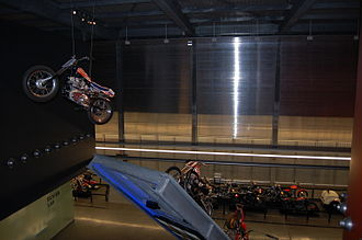 Evel Knievel - An Evel Knievel XR-750 suspended in air as if jumping, at the Harley-Davidson Museum