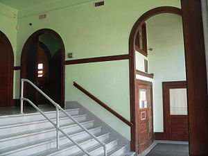Hartington City Hall and Auditorium -  Architect Steele continued the semi-circular motif from the front (west) facade into the doors and archways of the lobby.