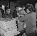 Heart Mountain Relocation Center, Heart Mountain, Wyoming. Customers line up at the counter as the . . . - NARA - 539197.tif