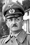 male in German uniform with peaked cap and toothbrush moustache