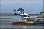 Helicopters landing Cairns Marina-1 (23496260222).jpg