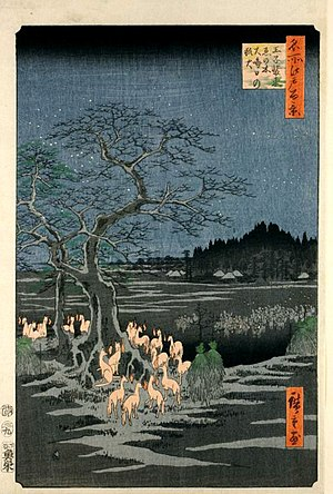 "Kitsunebi - ""Kistunebi on New Year's Night under the Enoki Tree near Ōji"" in the One Hundred Famous Views of Edo by Hiroshige. Each fox has a kitsunebi floating close to their face."