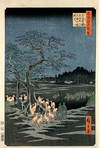 "Kitsunebi - ""Kistunebi on New Year's Night under the Enoki Tree near Ōji"" in the One Hundred Famous Views of Edo by Hiroshige. Each fox has a kitsunebi floating close to their face."