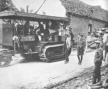 Holt tractor in 1916 towing artillery.