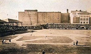"Boston Red Sox - The Huntington Avenue Grounds during a game. Note building from which the famous 1903 ""bird's-eye"" photo was taken."