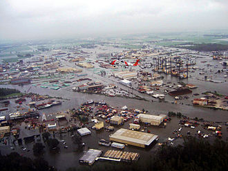 Hurricane Ike - A Coast Guard helicopter flying over New Iberia, Louisiana
