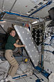 ISS-18 Sandra Magnus works on a crew quarters compartment in the Harmony node.jpg