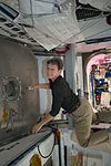 ISS-50 Peggy Whitson works inside the Harmony module to open HTV-6.jpg