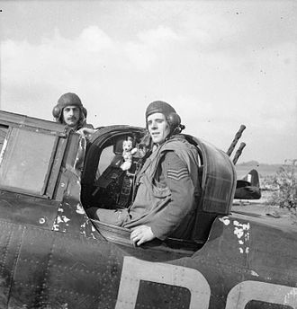 Teddy bear - An RAF Boulton Paul Defiant crew pose with their teddy bear mascot at RAF Biggin Hill during World War II