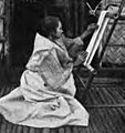 Ilocano woman combing cotton yarn.jpg