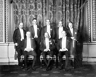 George V with his prime ministers. Standing (left to right): Monroe (Newfoundland), Coates (New Zealand), Bruce (Australia), Hertzog (Union of South Africa), Cosgrave (Irish Free State). Seated: Baldwin (UK), King George V, King (Canada). ImperialConference.jpg